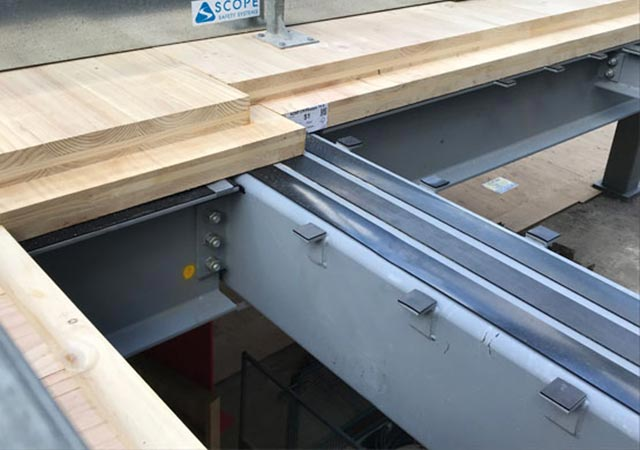 Neoprene 60 HG premium rubber bearing strips were installed on the building steel beams
