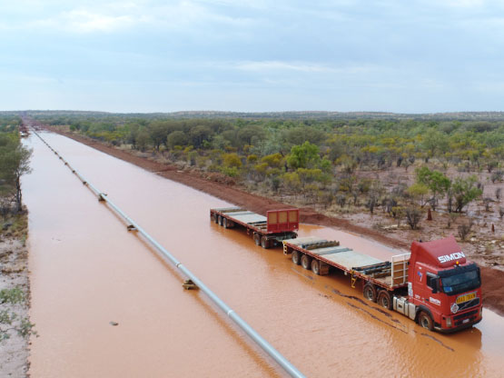 The load of steel pipes transported via road train were successfully and safely delivered